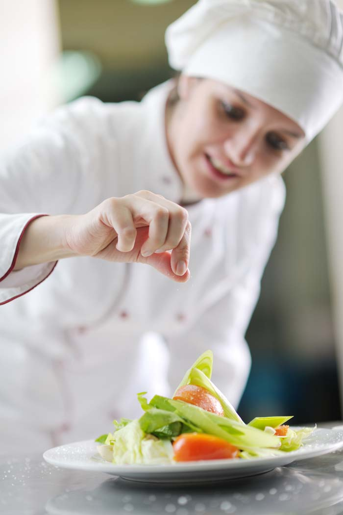 Chef plating a meal